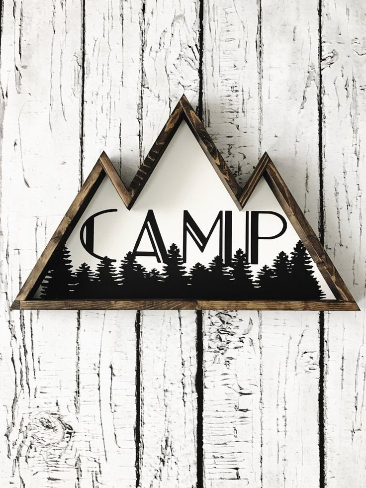 "This mountain shaped wooden sign with the word ""camp"" completes any adventure theme you have going on or would make the perfect gift for any campers dream space - 22"" along the bottom - painted with c"