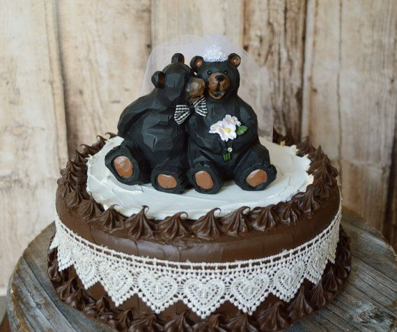 This listing is for a black bear wedding cake topper. The topper stands 4 tall and is shown on a 7.5 cake. They are made of a light weigh smooth
