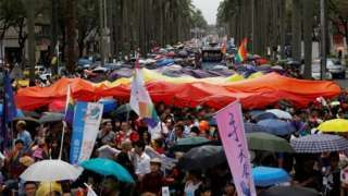 Image copyright                  Reuters                  Image caption                                      The rainbow flag, which represents the lesbian, gay, bisexual and transgender community, was visible across Taipei on Saturday                                Tens of thousands of people have taken to the streets of Taiwan's capital, Taipei, to partic