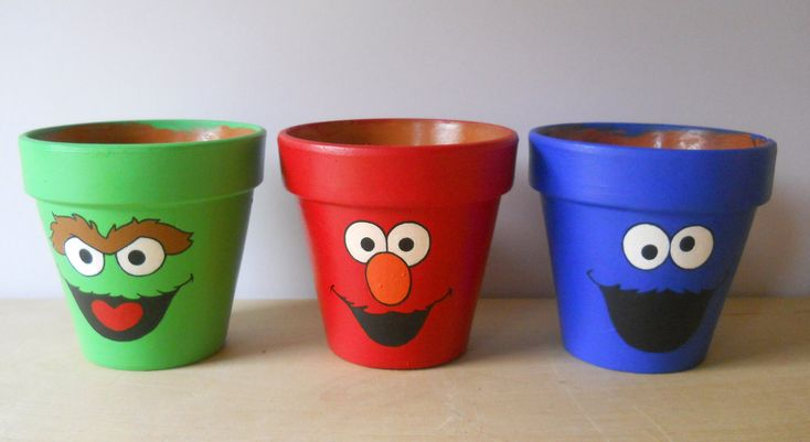 Sesame Street Elmo Cookie Monster Oscar hand painted flower pot set. $38.00, via Etsy. These would be so cool to teach kids to take care of plants.