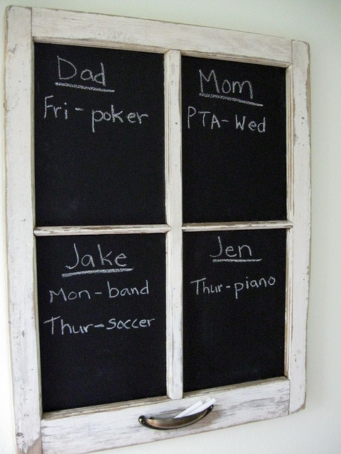 Old barn window + chalkboard paint!  I made one and have it in my kitchen.  SUPER cute.