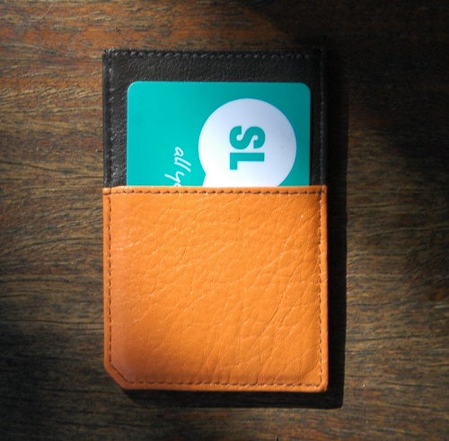 Our orange and dark brown full grain leather, 5 pocket cardholder. Credit card, bus pass and a secret pocket for notes. It's called our Friday Night Special.