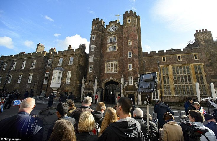 Break in the clouds: After standing in wet, windy conditions crowds gathered in the Autumn sunshine at St James Palace to see the future king