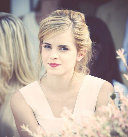 emma watson, love this hairstyle wish i had a shot of the back ..looks like a loose bun maybe??