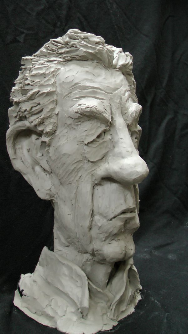 A sculpture titled 'Bust of Sir Ian McKellen (Caricature Portrait statue)' by artist Richard Austin in the category Portrait Sculptures / Commission or Bespoke or Customised Sculptures. This sculpture has the dimensions of 28 cm, the sculpture is sculpted from a medium of 'resin Composite'. Sir Ian McKellen Satirical Cartoon Portrait Head Bust Unique sculpture for sale for Indoors Inside in the House or Office by the Humourist Sculptor Richard Austin, who can create these...