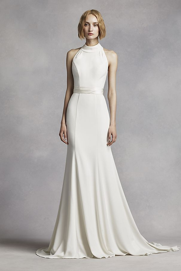 This minimalist chic crepe gown will have you looking classicly flawless as you say your I Do's!  4  extra length gown.  Halter bodice features a chic, high neckline and contoured seaming detail for