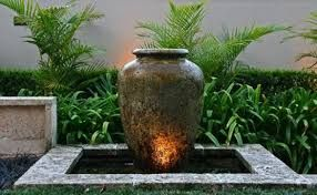 balinese gardens.... this in black/grey for the front yard as a bubbling water feature with lights!