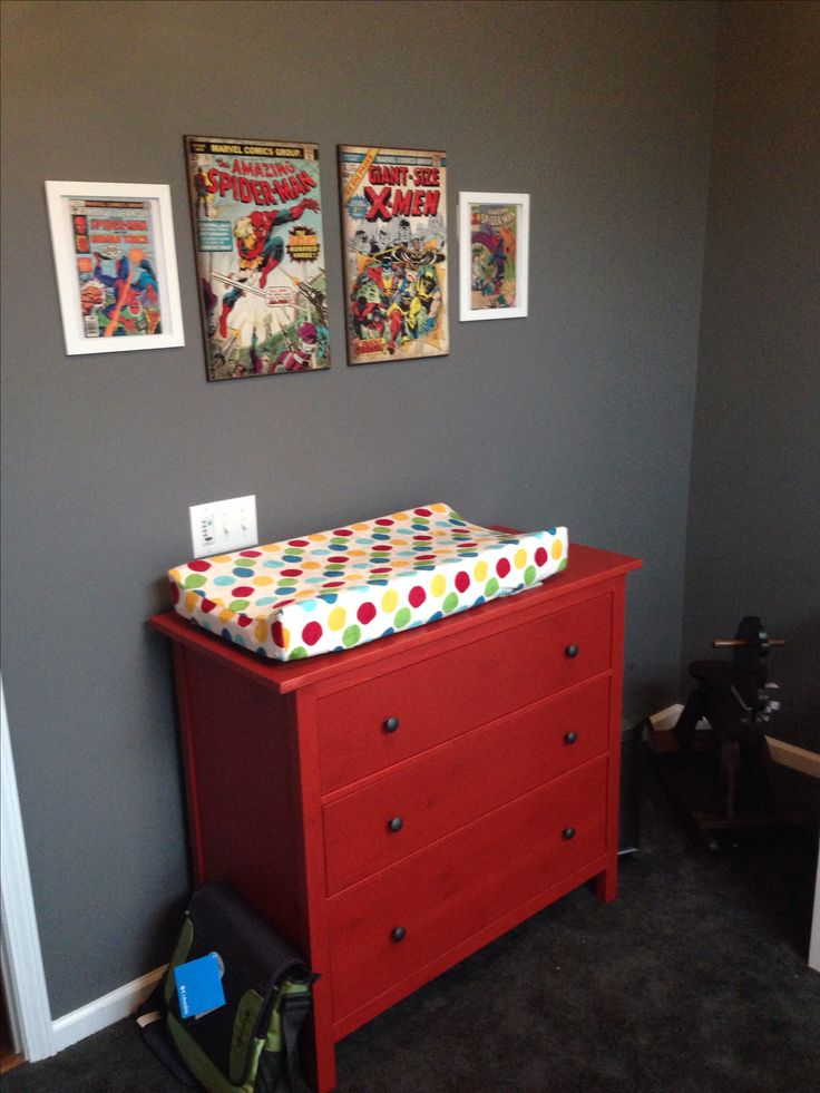 Superhero Nursery- Hemnes dresser from IKEA; framed comic books from my husband's collection; large comic art from Hobby Lobby and Ross; changing pad from Babies R Us; changing pad cover from Amazon (Kids Line Velour- Animal Parade); the rocking horse was made by my husband's late grandfather when he was a child :)