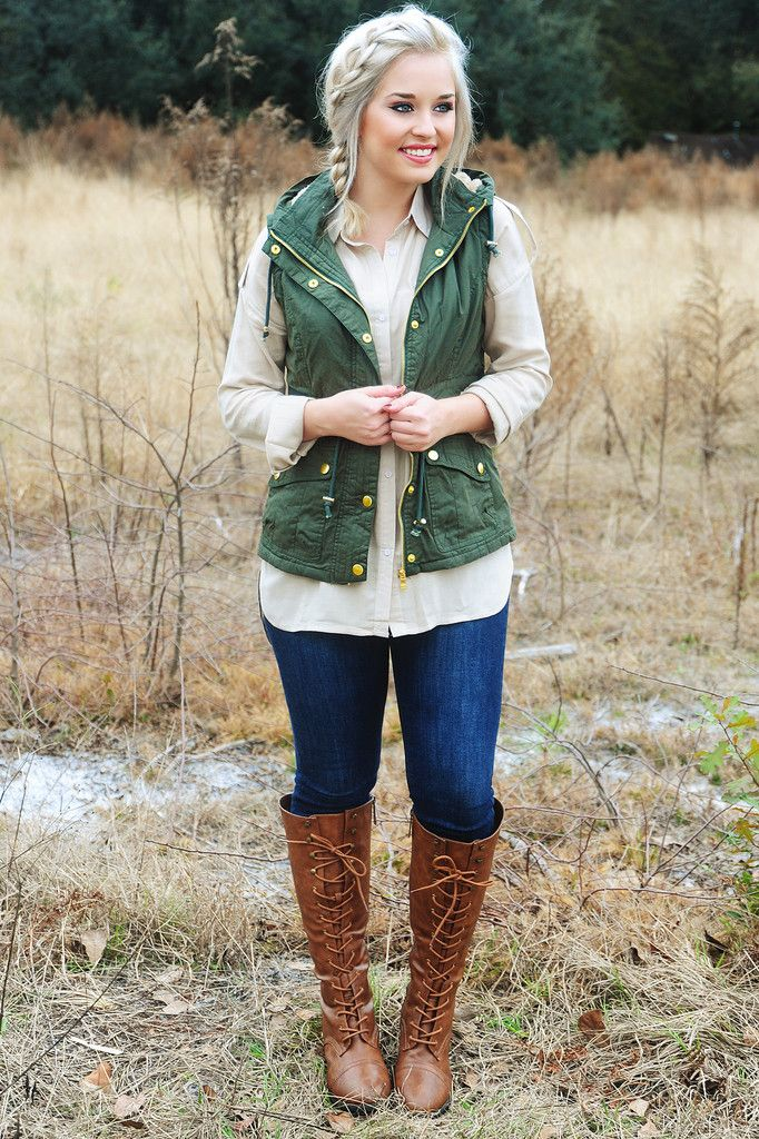 Army green vest, beige chiffon button down, skinny jeans, brown riding boots