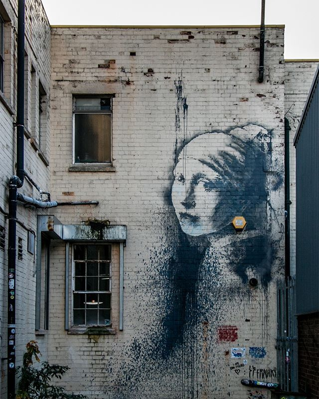 Girl With The Pierced Eardrum Found On A Wall At The End Of A Short Alley On Spike Island In Bristol Is Whats Known As The Girl Dutch Artists Street Art