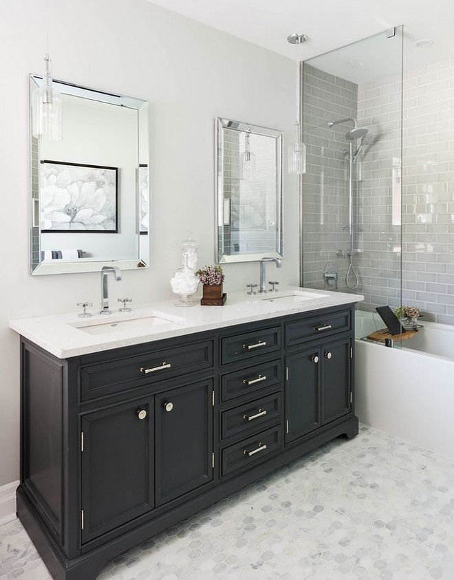 gray hex floor tiles paired with gray subway tile in the shower