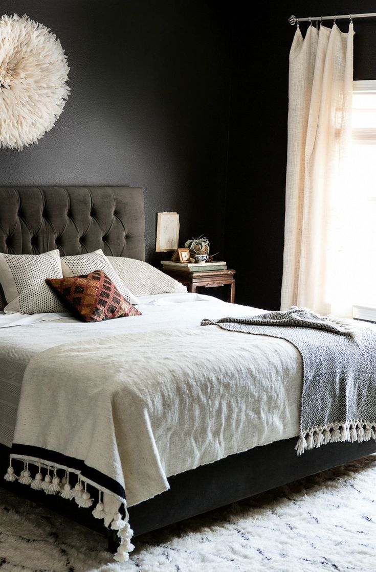 Black walls in the bedroom satisfied Morse's desire for drama and sophistication, but light bedding, curtains, and accessories (like that an eye-catching lamp) combat any dreariness.   - CountryLiving.com
