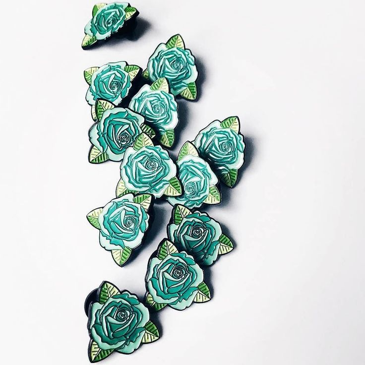 Repost @heroesforhireco  Made a few tweaks and decided to bring the teal rose back. Now available at heroesforhireco.com     (Posted by https://bbllowwnn.com/) Tap the photo for purchase info.  Follow @bbllowwnn on Instagram for the best pins & patches! [Image Description: Enamel pin and embroidered patch for sale on background]