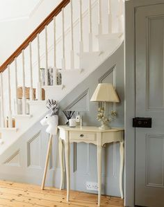 Turn a traditional hallway into an elegant and airy space that's full of light by painting the walls and staircase white