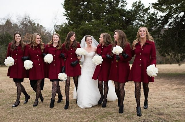 Have your bridesmaids sport similar coats for your winter wedding.