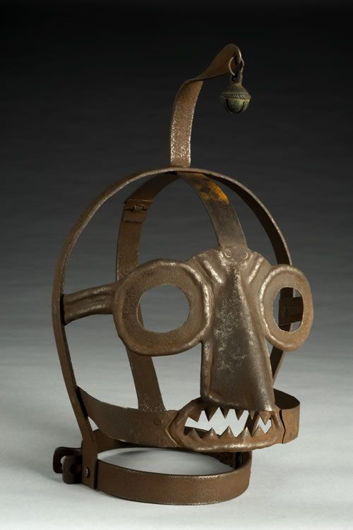 "That's the ""Scold's Bridle,"" a gruesome mask used as punishment for ""rude, clamorous woman,"" who are considered to be spending too much gossiping or quarreling in the Medieval times. It came complete with a bell on top, no less:  Time spent in the bridle was normally allocated as a punishment by a local magistrate.  When wearing the mask it was impossible to speak."