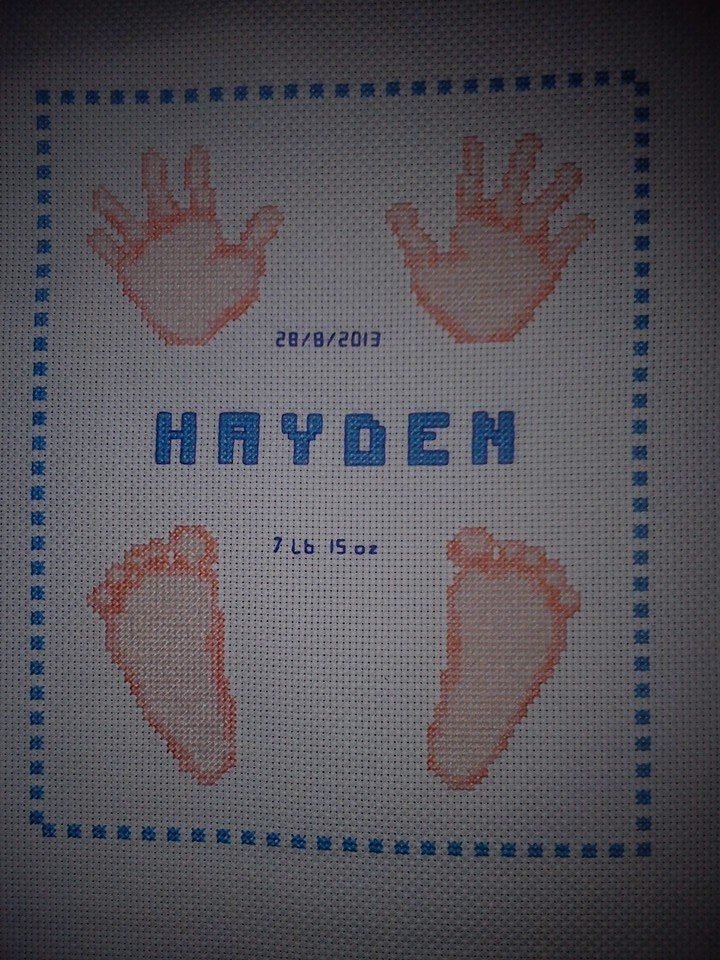 cross stitched hands and feet, designed and cross stitched by tulipacious deisngs.