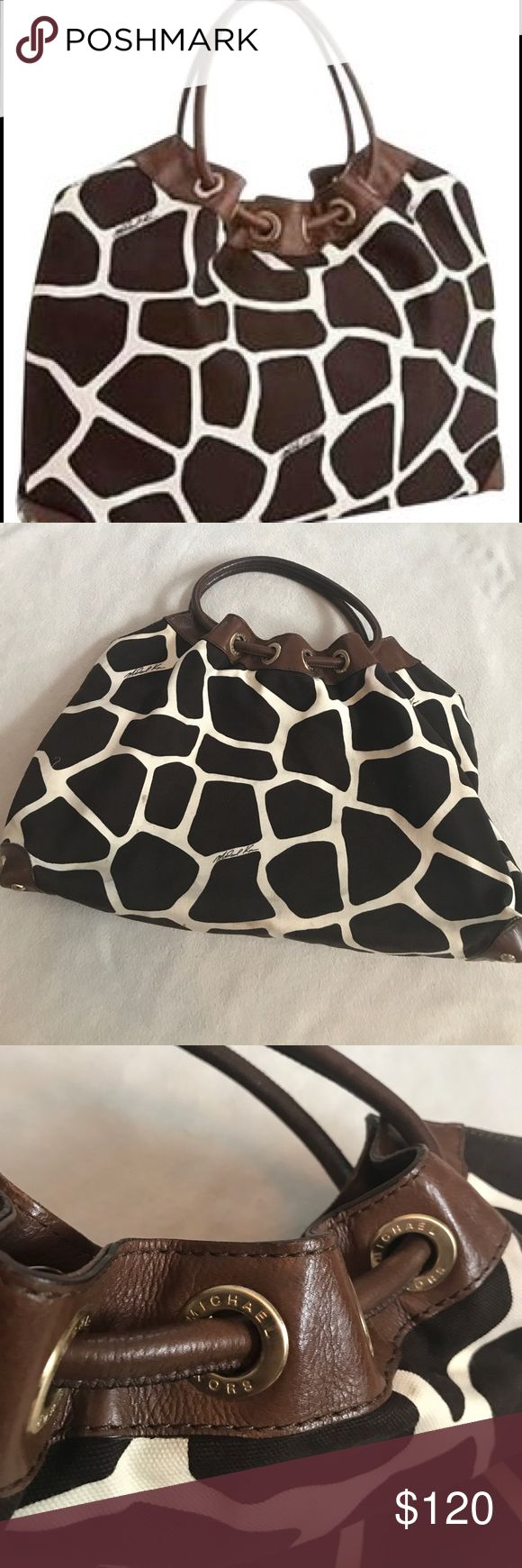 """Michael Kors Giraffe Joplin Hobo Tote Bag 17"""" length with handles 12"""" height without handles. 19"""" width. Has leather top with Roberts. Leather handle. Giraffe print. Hobo bag. Joplin hobo bag. Has small marks on outside and a small stain inside otherwise excellent condition. Has inner zippered pocket and slit storage. Bundle 2+ items for a discount MICHAEL Michael Kors Bags Hobos"""
