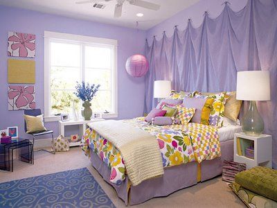 """This teenage girl """"eclectic"""" bedroom is dominated by shades of purple. Instead of a headboard, lightweight fabric covers the entire wall behind the bed. Southern Living magazine."""