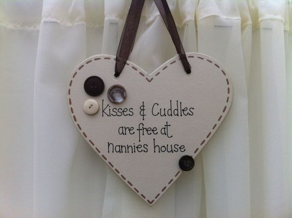 Handmade 'Kisses and cuddles...' wooden plaque on Etsy, £9.00