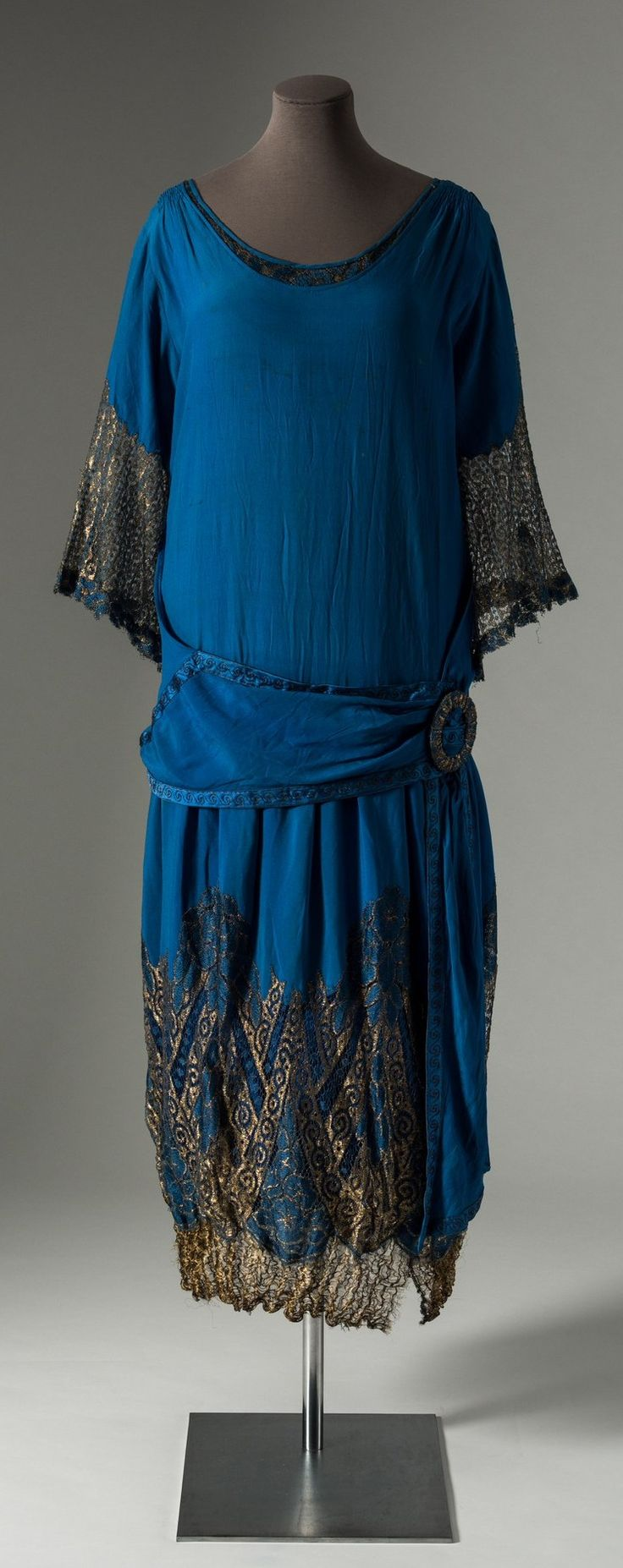 Blue silk crepe dress trimmed with gold metal thread lace, 1920s. Collection of Fashion Museum Bath, via @Fashion_Museum on Twitter.