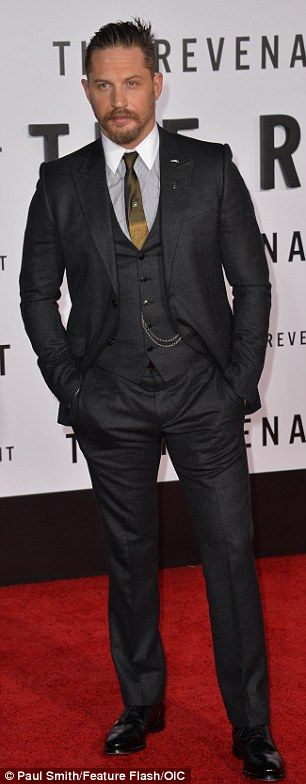Showing his style: 38-year-old actor Hardy sported a black three piece suit over a grey dress shirt with a white collar and brown tie