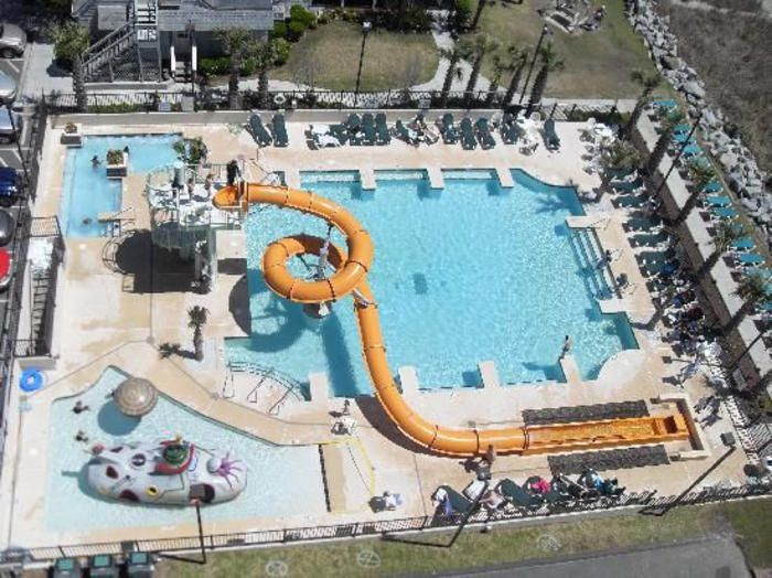 "This is Carribbean Resort""s outdoor water park. This resort also has an indoor pool lazy river restaurants starbucks nearby and a quick walk to the famous @seacaptainshouse. Call 800-525-0225 and go to our Link in Bio for more details. #MyrtleBeach #family #amentiesgalore #waterpark #fun #beach #summer #vacation"