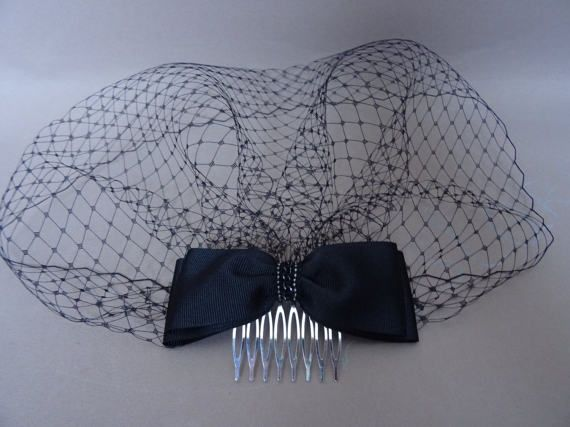handmade with love in the UK vintage inspired black french net birdcage veil (18cm / 7drop) with a double grosgrain ribbon on metal satin covered comb for an easy and secure placement (could be worn on either side of the head) perfect for any formal occasion please check delivery time to your country in my shops policies section before placing your order thank you for looking