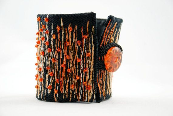 "bracelet-cuff ""Clementine"" is made out of upcycled Jeans stripe, machine embroidered in orange and hand sewed beads in orange. by Meret on etsy"