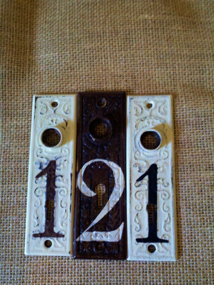 Repurposed antique door plates to use for table markers