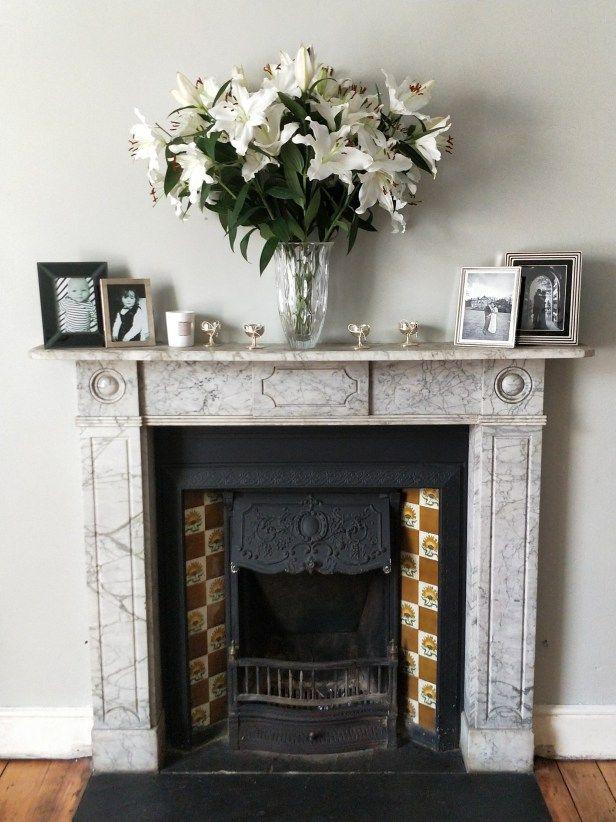 Living Room Decor: Marble Fireplace. Grey walls. Original features.  #homedecor #sittingroom #livingroom #fireplace #originalfeatures #granite #marble