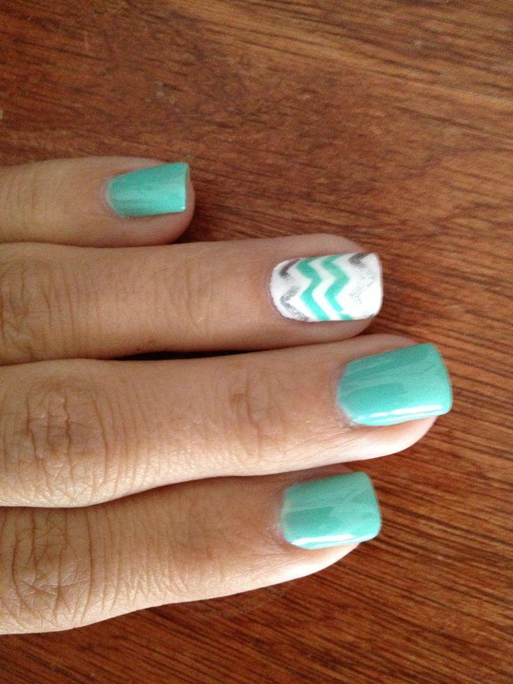 Mint chevron nails... Like the ring finger nail