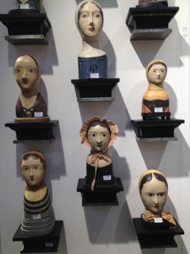 beautiful dolls heads on individual wall mounts