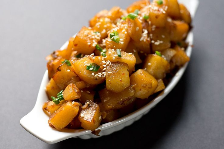 Easy recipe for korean style caramelized potatoes braised with garlic, red pepper flakes, soy sauce, brown sugar.