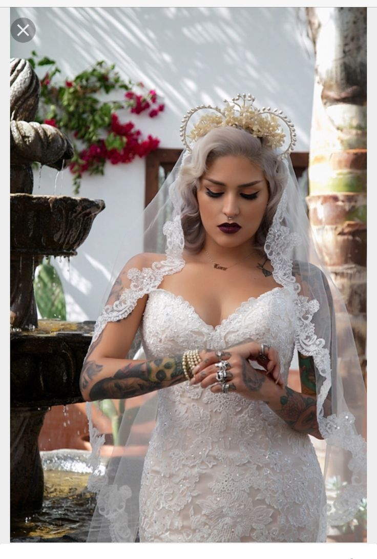I love how this images depicts a badass tattooed bride i for Tattoo wedding dress