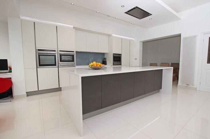Matt White Laminate Kitchen - White matt laminate kitchen with Anthracite grey kitchen island - Discover more at www.lwk-home.com