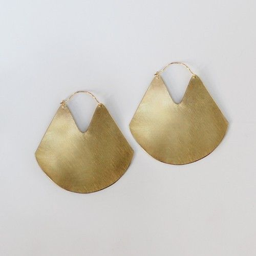 gold earrings.