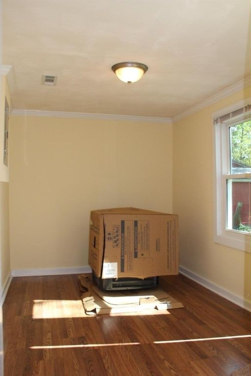 OFF KITCHEN? KEEPING ROOM? -TV/FIREPLACE, PUB TABLE FOR THE STOOLS- BACK DOOR BESIDE WINDOW - ELECTRIC PANEL ON LEFT -37 Wheeler Ave,