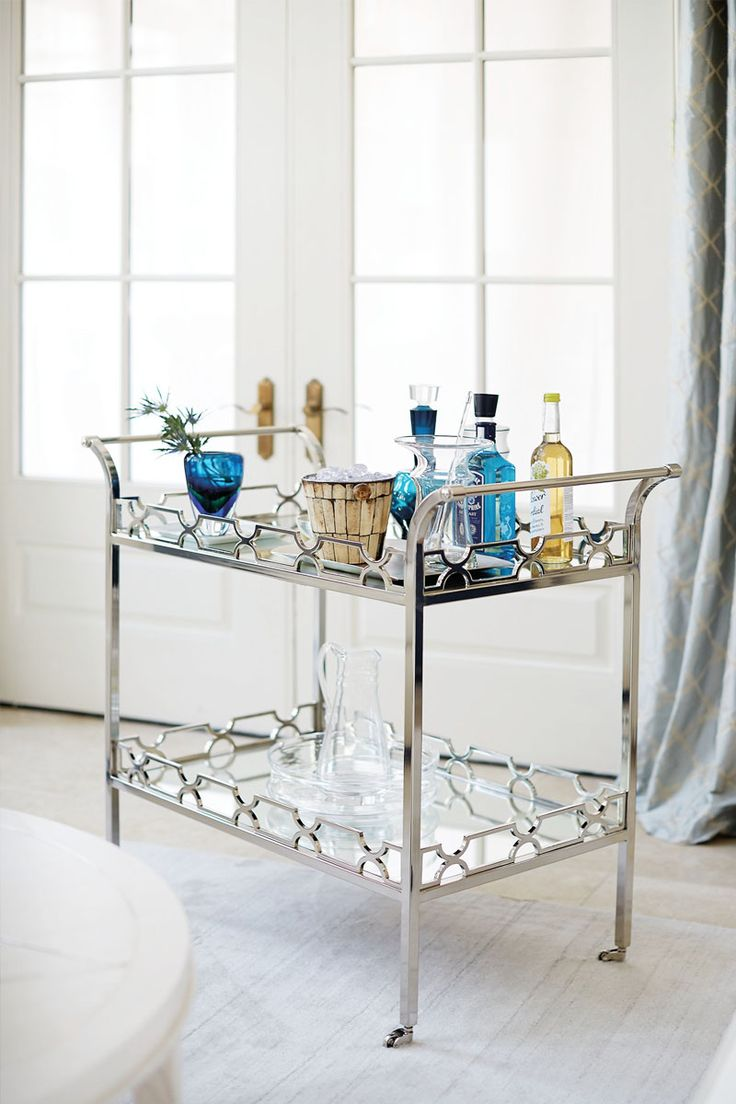 5. A Beautiful Bar Cart    Bar carts are a stylish entertainment solution when you don't have a bar or lots of counter space in your home. They can be effortlessly tucked into nooks and corners, aside couches, or in the kitchen. And even if you do have a larger space, a bar cart is great because you can bring it wherever the party goes! Need more advice on selecting the perfect one? Read up on our bar cart best practices.