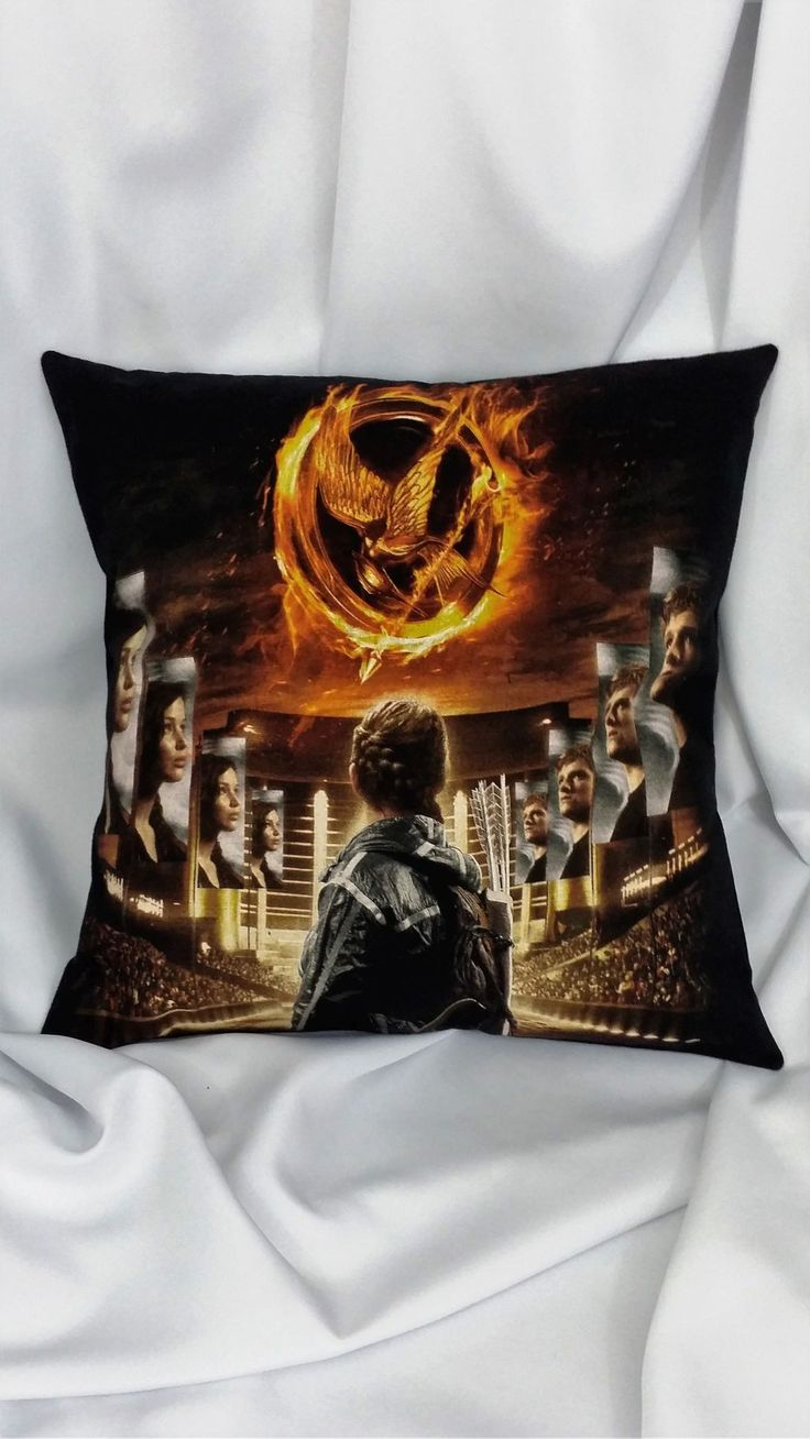 The Hunger Games Girl on Fire black t-shirt made into a pillow cover. Heroine bedding