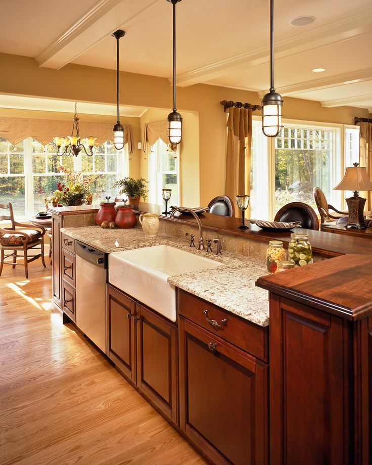 attractive Kitchen Island With Farmhouse Sink #1: farmhouse sink and lights and granite...even like windows in background
