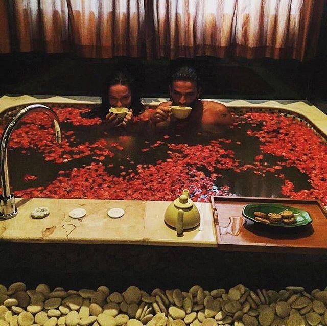 Soak your troubles away in a bathtub full of rose petals  Great photo: nino_langella