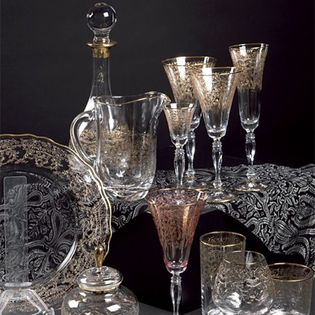 """PIZZO"" COLLECTION GLASSES  Hand Blown Tray with pantograph and gold, diam cm 32, box 1 p. Hand Blown Bottle cl 90 with pantograph and gold, h. cm 26, box 1 p. Hand Blown Carafe cl 109 with pantograph and gold, h. cm 18,5, box 1 p. Crystal Glasses with pantograph and gold, h. cm 17, box 6 p. Crystal Glasses with pantograph and gold, h. cm 17, box 6 p."