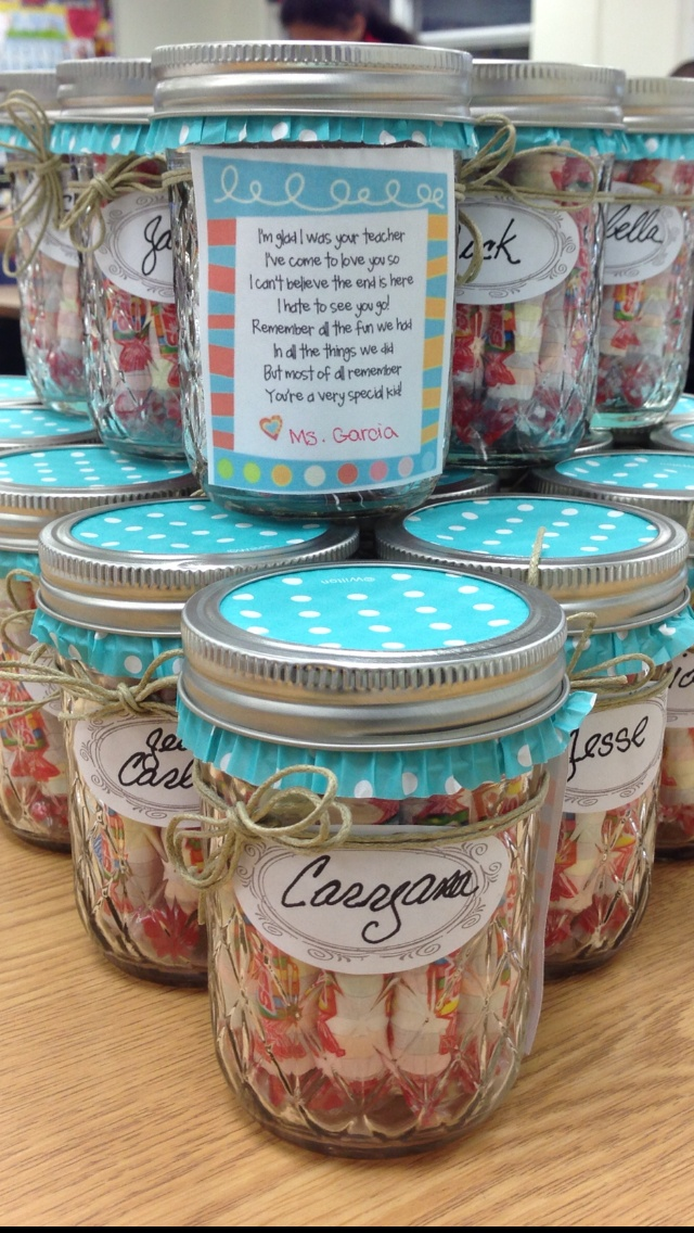 """Made these little jars for my students. Wrote each students name on the jar and then attached a poem to it. The jars are filled with Smarties for my little """"smarties"""" and Hersey hugs and kisses to send them on their way with hugs and kisses from me. I used a cupcake liner on the tops of of each jars."""