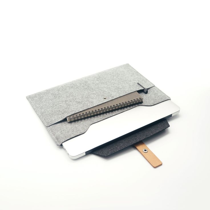 This designer MacBook sleeve combines minimalism and functionality.Features a mixture of leather and 2 colours of wool felt,Also a storage compartment for notepad, wallet, etc. Keeps you stylish and fashionable while on the move with your Macbook.