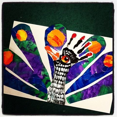 Peacock:arm-hand painted black; finger tips-thumb painted orange; painted-paper collage tail