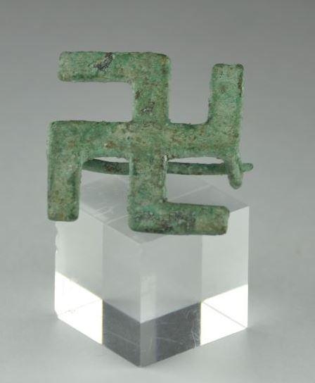 Roman bronze swastika brooch. Private collection