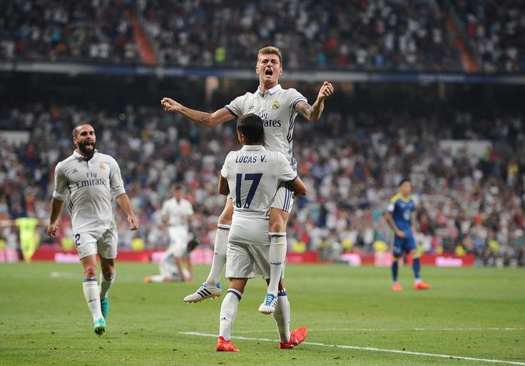 Toni Kroos of Real Madrid celebrates with Lucas Vazquez after scoring Real's 2nd goal during the La Liga match between Real Madrid CF and RC Celta de Vigo at Estadio Santiago Bernabeu on August 27, 2016 in Madrid, Spain. (Aug. 26, 2016 - Source: Denis Doyle/Getty Images Europe)