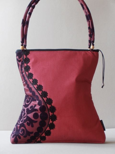 red jeans bag with taffeta decoration
