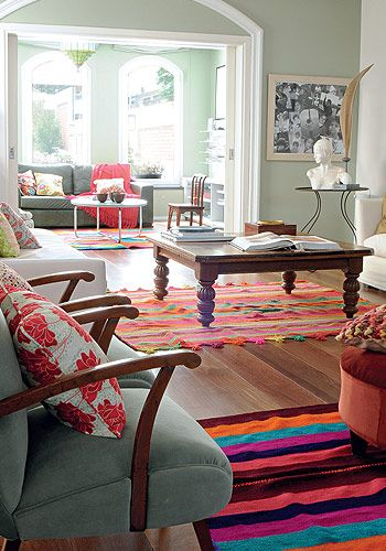 cute, different rugs though and some of the decor accents I'd change, and maybe the coffee table too.